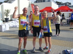 Simon Hunt, Steve Cox and Gemma Bragg celebrate finishing the 10k
