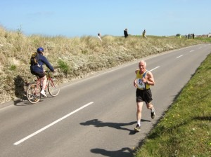 Ian Graham approaching the finish at the 10k - must do something about those shorts!