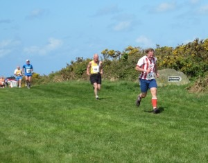 Ian Graham - those shorts again! - at the finish of the Cross Country with Dave Parsons in the background