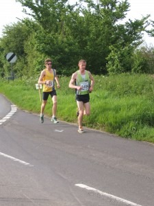 Toby Chapman pursues a relay runner at 2 miles