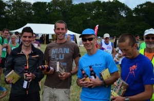 Chris O'Brien, Steve Way (course record holder), Steve Way and Jacek Cieluszecki celebrate their team win at New Forest 10