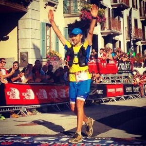 Jez Bragg celebrates finishing the Ultra-Trail du Mont-Blanc