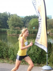 Emma Dews approaches the finish (1st lady)