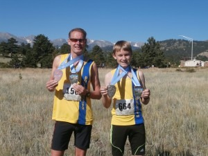 Simon and Sebastian Hearn display their medals won in the Rocky Mountain Half Marathon