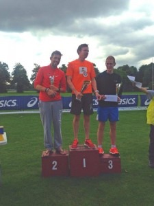 Peter Thompson (2nd) and Billy McGreevy (3rd) on the Fulham & Putney Half Marathon podium
