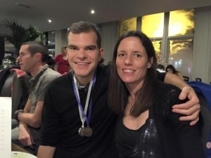 Jon Sharkey with his County Medals enjoys the Christmas meal with Lauretta.  Steve Way, BAC's other International athlete, behind.