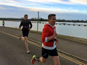 Paul Hill (in the Christmas jersey) on his way to winning the Poole Parkrun on Christmas Day