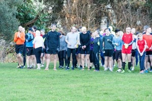 Paul Hill (all in black apart from yellow hat) and others await the start of the Bournemouth Parkrun on New Year's Day