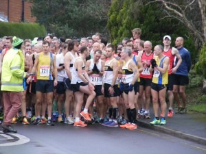 Jon Sharkey, Paul Hill (partly hidden) and Graeme Miller listen to the pre-race instructions at Broadstone