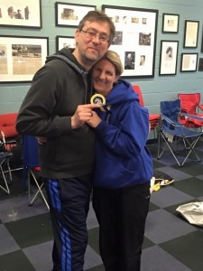Caroline Rowley proudly displays her Boston Marathon medal