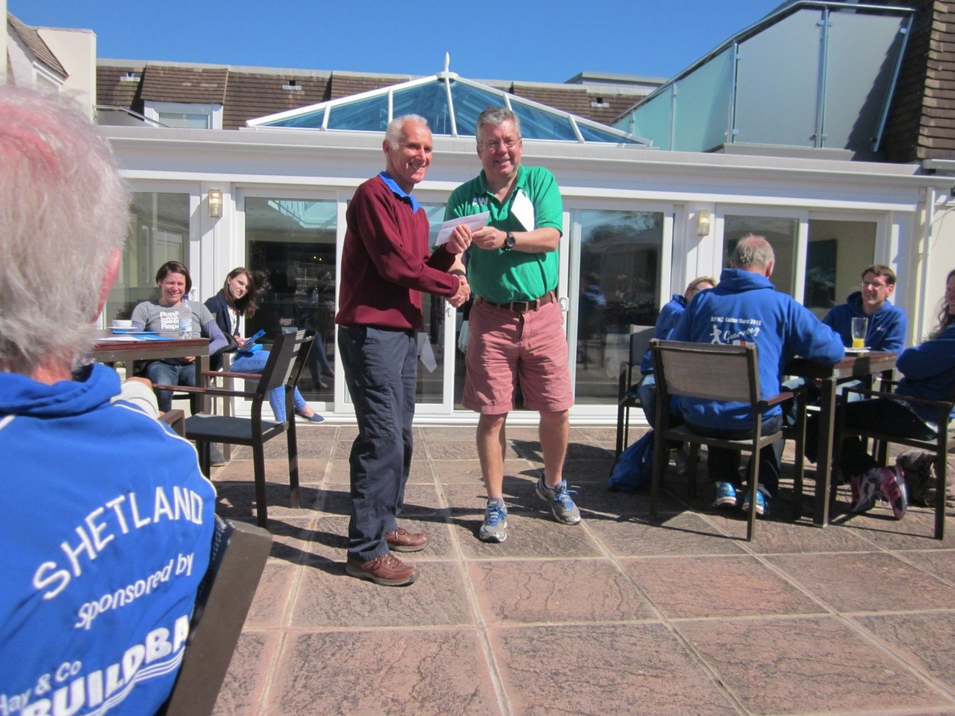 President Ian receiving one of his prizes from Guernsey IAAC President Alan