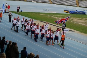 Pat Robbins carries the GB flag at the 24 hr World Championships (with Paul Consani recording the event on video)