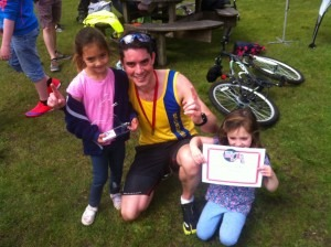 Chris O'Brien celebrates his win in the DYMB Moors Valley 10k