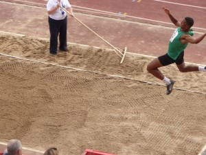 Patrick on his way to gold in the long jump