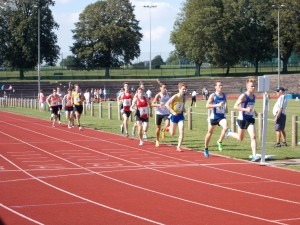 David Long and Lewis Sainval approach the bell in the 800m