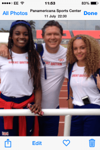 Zac Kerin with his athletes Naomi Ogbeta and Emily Wright in the stadium at Cali, Colombia