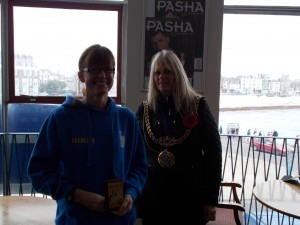Nikki Sandell is presented with the Weymouth 10 3rd Lady trophy by Weymouth's Mayor