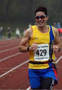 Chris O'Brien working hard to achieve a PB in the Lancaster Half Marathon