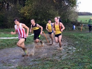 Rob McTaggart fights through the mud towards a 16th place finish