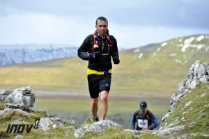 Damian Boyle about to conquer Ingleborough with Whernside in the background