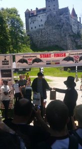 Heidi Tregenza receives her award for 2nd lady in the Transylvania 30k, with Dracula's Castle in the background