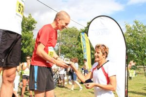 Local running legends....Carol Doe presents the Bronze Medal to Jerry Shield for the Mens' Race