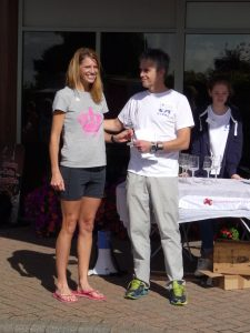 Emma Dews is awarded the prize for 1st lady