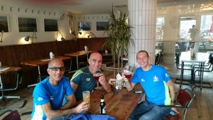 Sanjai Sharma relaxes after the Amsterdam Marathon with Simon Way and Nigel Rogerson