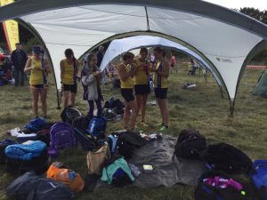 Ladies' Team relaxes after their race with Anya Sandell (third from left) who had also competed earlier