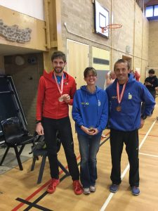 Toby Chapman and Jacek Cieluszecki with their London Marathon 3rd team medals and (centre) Nikki Sandell with Hants XC League lady veteran trophy