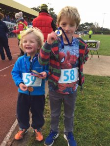 Gemma Bragg's nephews Noah and Arlos show off their 1.5k race medals
