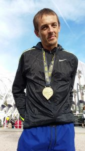 Jacek Cieluszecki with his Valencia Marathon medal