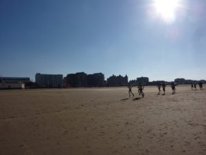 The lead group make their way across the sandy beach