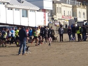 The lead group charge along the sandy bay