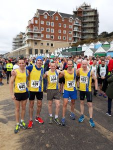 BAC men at start line for Easter Quarter Marathon