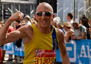 Graeme Miller shows off the guns in the London Marathon