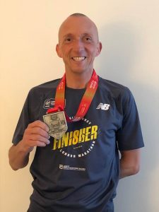 Graeme Miller with his finisher's medal and t-shirt