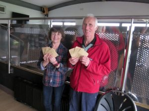 Ian Graham and Jenny Morgan collect their winnings in Guernsey Easter Runs