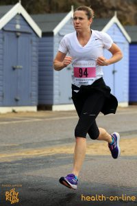 Jo Dilling powers along the promenade in the Bournemouth Bay 10k
