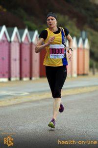 Julia Austin powers along in Bournemouth Bay 10k