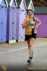 Kirsty Drewett looking happy in Bournemouth Bay Half Marathon