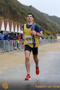 Lazslo strides to the finish of the Bournemouth Bay Half Marathon