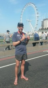 Pete Thompson shows off his finisher's medal