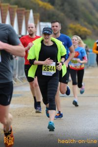 Sam Laws bursts toward the finish in the Bournemouth Bay Half Marathon