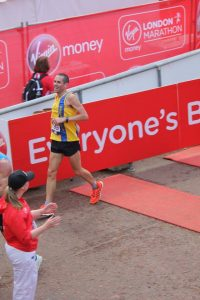 Steve Way goes across the finish line in the 2018 London Marathon