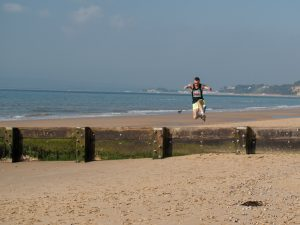 Trevor Elkins hurdles the groyne in Race the Tide Beach Race