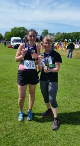 Roz and friend with Prosecco after the run