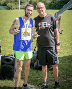 Trevor Elkins wins Run the River 15k race