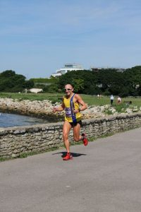 Graeme Miller by wall in Poole Half Marathon