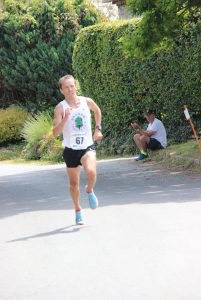 Jacek Cieluszecki way out in front at the Lulworth Castle 10k